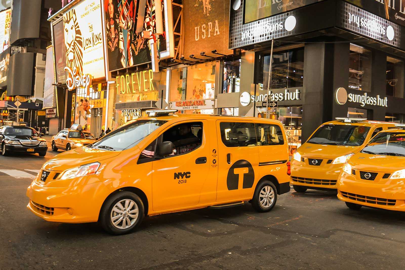 Wheelchair taxi van on New York City street.