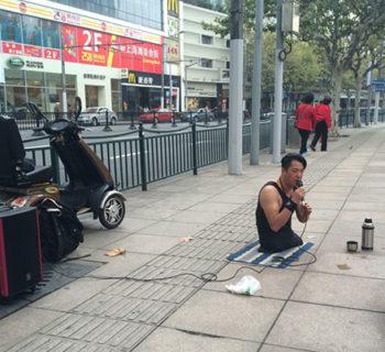 Chen Zhou Legless Street Performer
