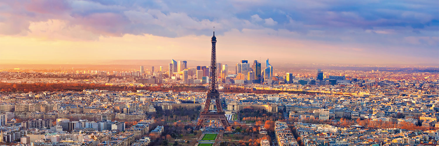 PHOTO: Paris skyline at dusk, with the Eiffel Tower at the center.