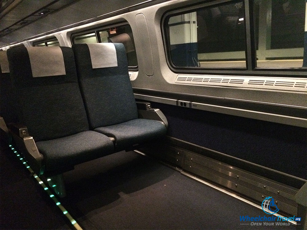 PHOTO DESCRIPTION: Wheelchair space on an Amtrak train car.