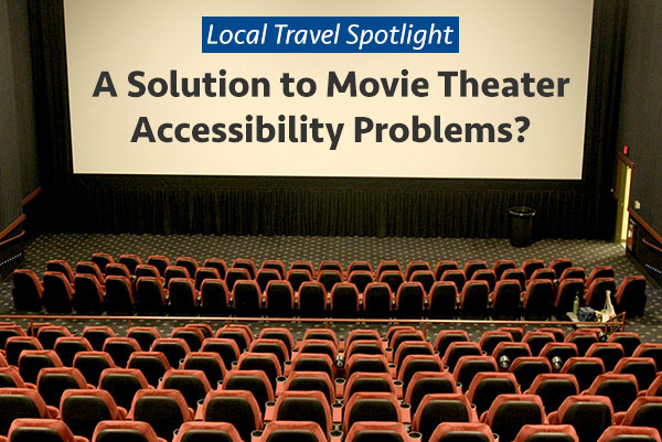 Photo Description: Photo taken from the top row of a movie theater, showing the stairs down to the entrance and the wheelchair space at the very front of the auditorium.