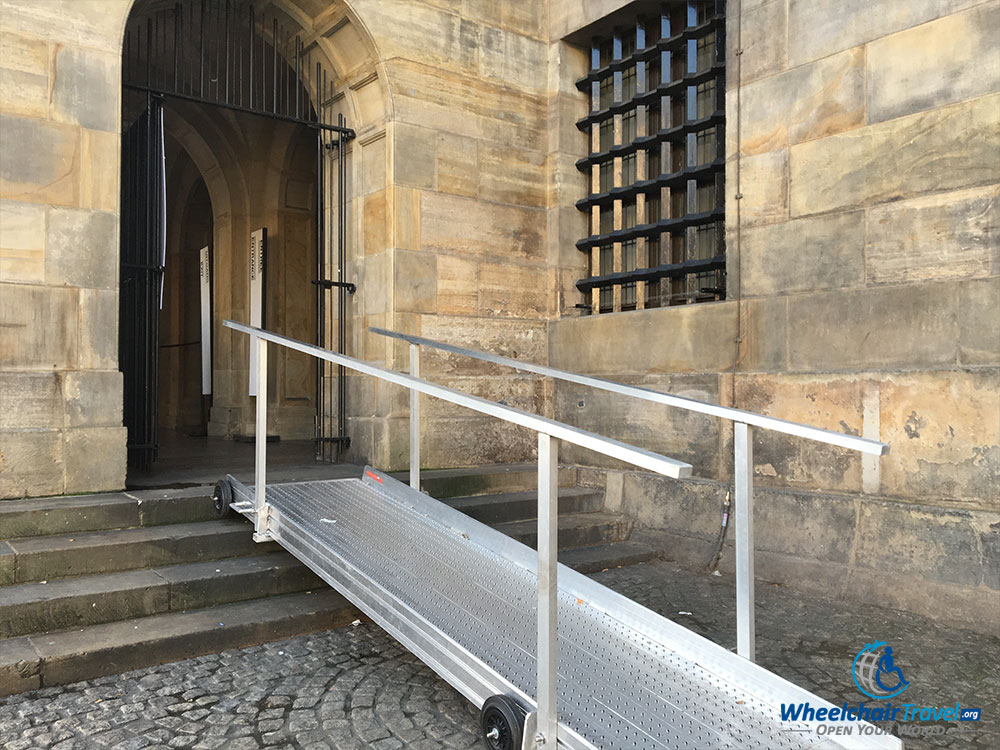 PHOTO DESCRIPTION: A metal, wheelchair accessible ramp leading to the entrance of the Royal Palace of Amsterdam.