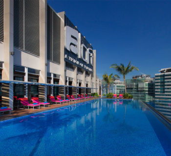 PHOTO DESCRIPTION: Exterior of the Aloft Kuala Lumpur Sentral Hotel, as seen from the rooftop pool deck.