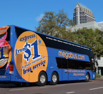 PHOTO DESCRIPTION: Megabus parked on a street in Florida.
