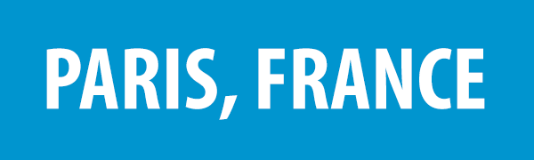 PHOTO DESCRIPTION: White text on a blue background that reads PARIS, FRANCE.