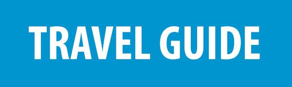 PHOTO DESCRIPTION: White text on a blue background that reads TRAVEL GUIDE.