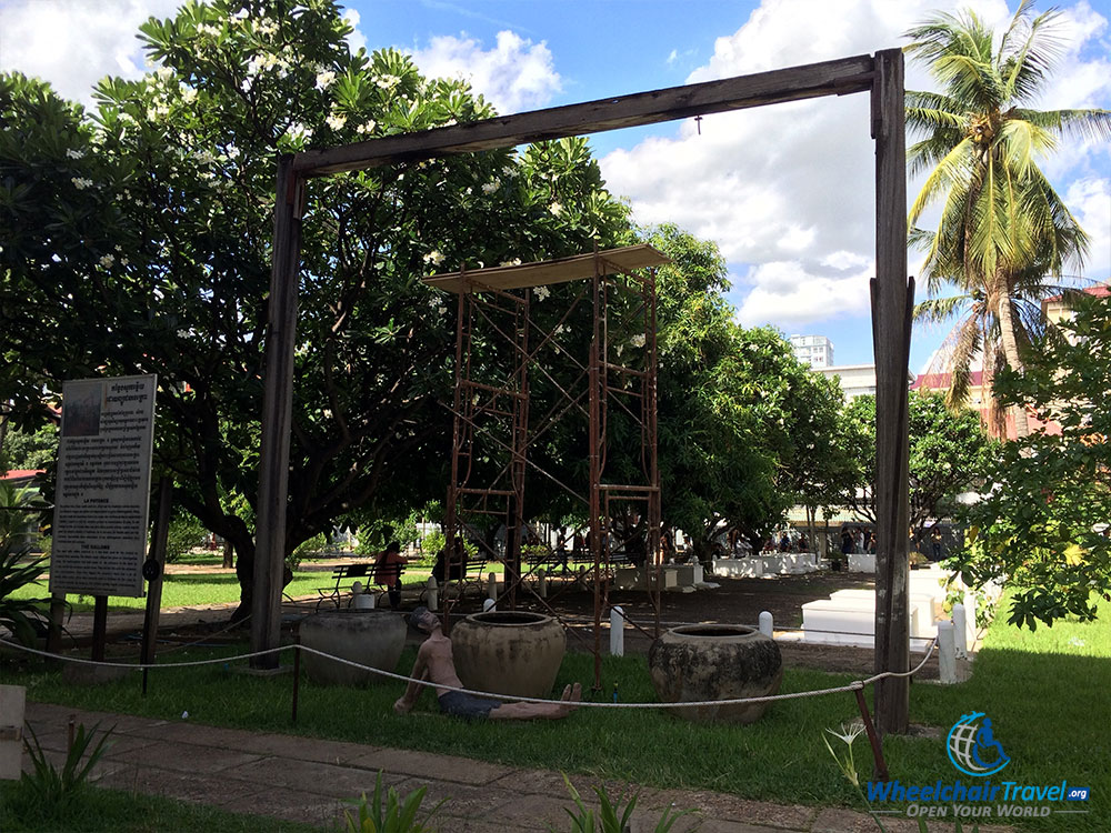 PHOTO DESCRIPTION: Wooden gallows in the courtyard at Tuol Sleng Genocide Museum.