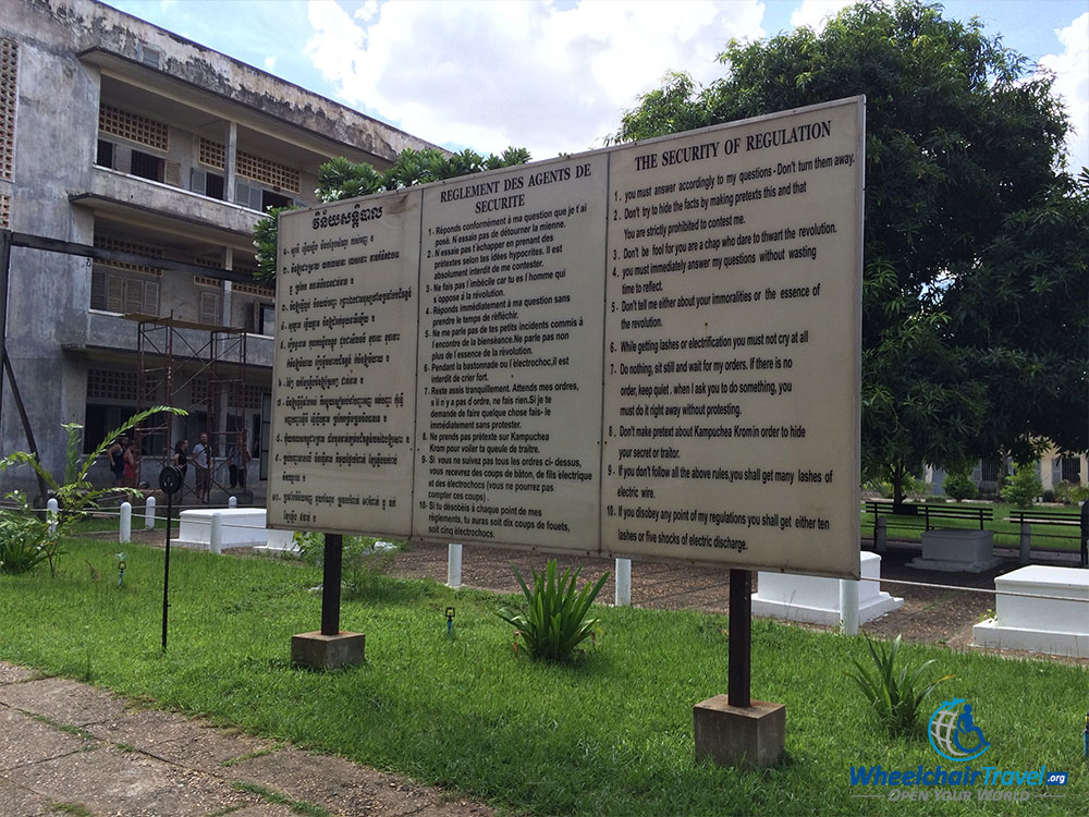 PHOTO DESCRIPTION: The camp's 10 rules for behavior posted on a sign just inside the prison gate.