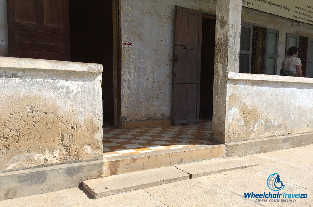 PHOTO DESCRIPTION: Steps leading to a building prevent wheelchair access.