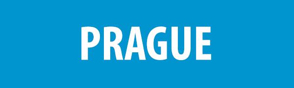 PHOTO DESCRIPTION: White text on a blue background that reads PRAGUE.