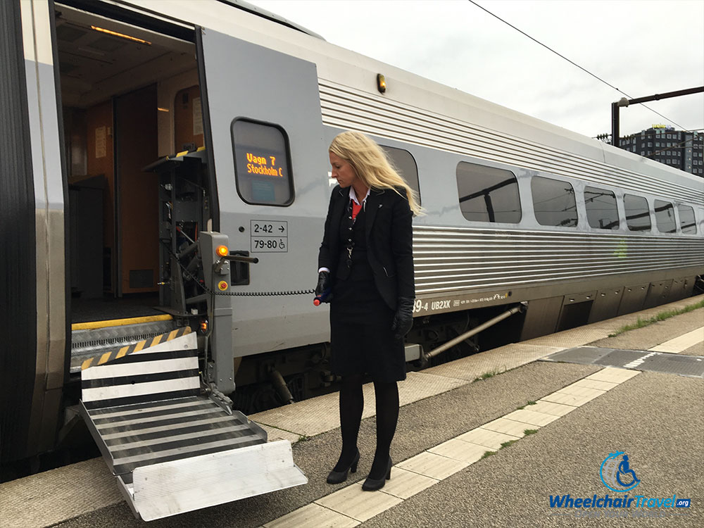 Built-in wheelchair lift on the SJ high speed train, operated by female conductor.