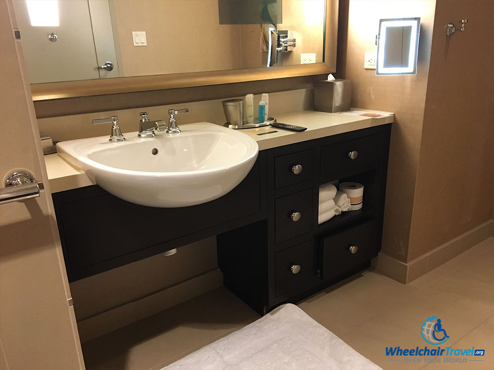 Review omni dallas hotel wheelchair accessibility for Wheelchair accessible sink bathroom