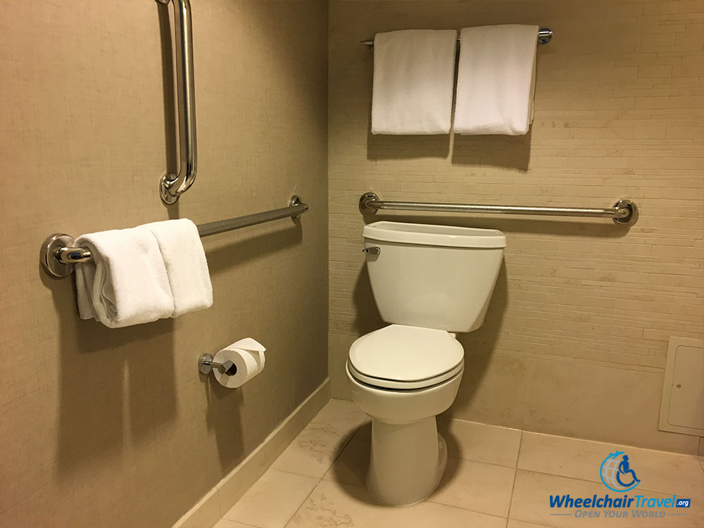 Bathroom toilet with grab bars at Hyatt Centric Arlington hotel