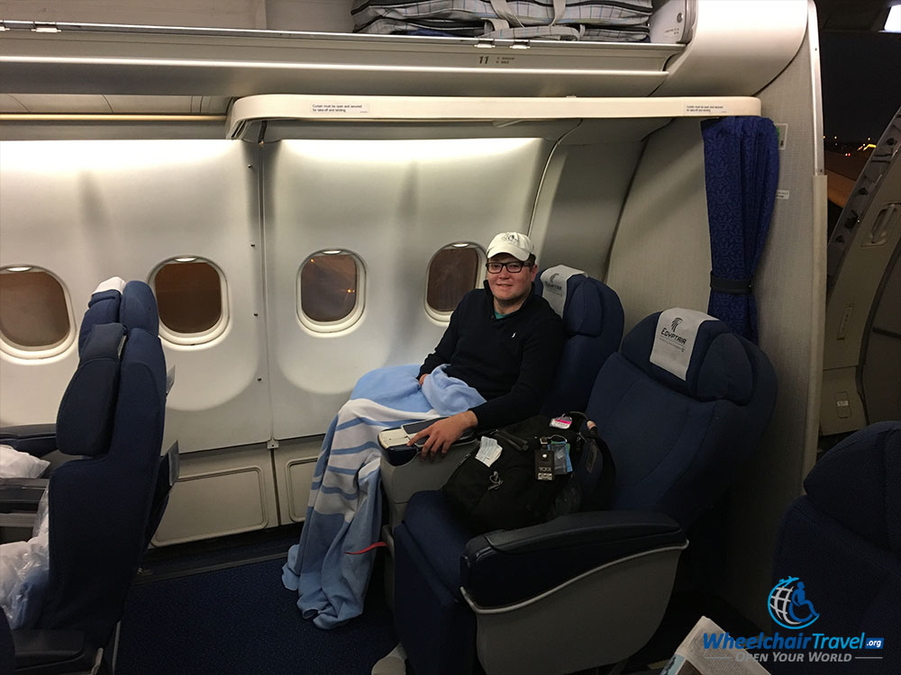 John Morris seated in EgyptAir business class