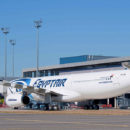 EgyptAir Airbus A330-300 parked at remote gate stand