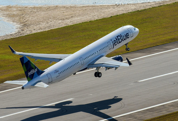 JetBlue Airways airplane taking off from an airport runway