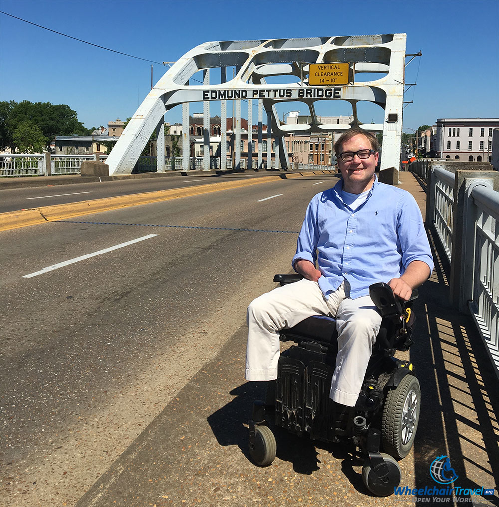 Another angle of wheelchair user John Morris on the Edmund Pettus Bridge