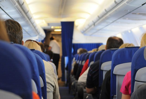 Airplane cabin full of passengers - Air Carrier Access Amendments Act