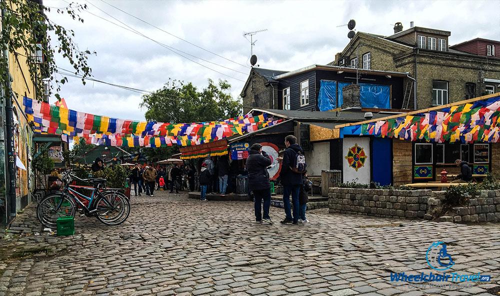 Cobblestone street in Freetown Christiania, Copenhagen, Denmark.