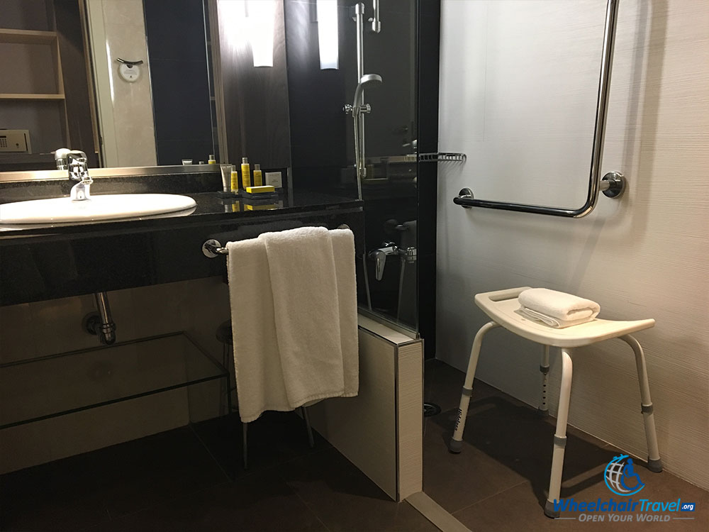 Bathroom sink and wheelchair accessible roll-in shower.