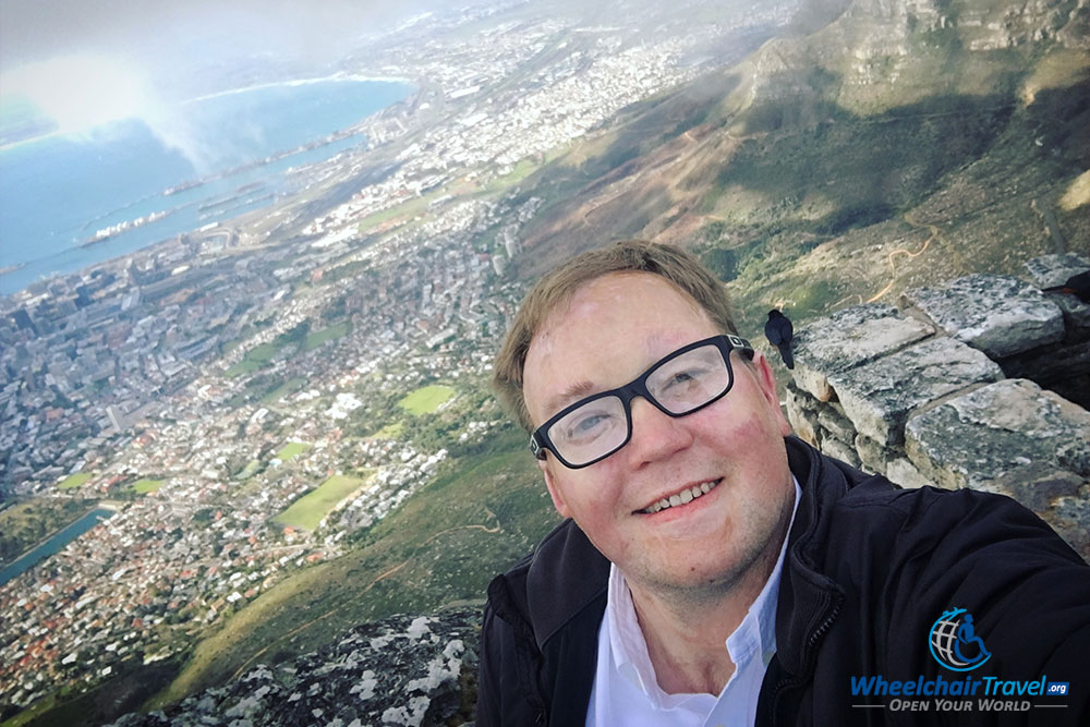 Taking a selfie on Table Mountain, with the city of Cape Town in the background