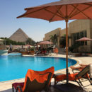 Le Meridien Pyramids Hotel & Spa swimming pool with Egyptian Pyramid in the background
