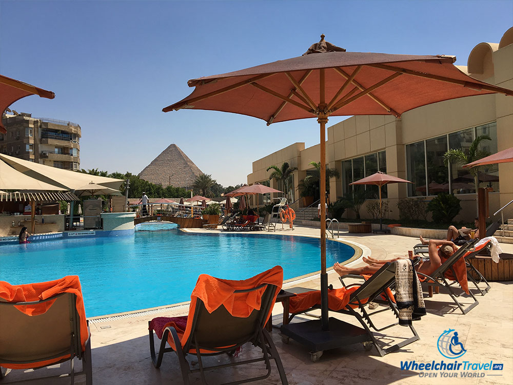 Le Méridien Pyramids Hotel swimming pool, with an Ancient Egyptian Pyramid in the background.