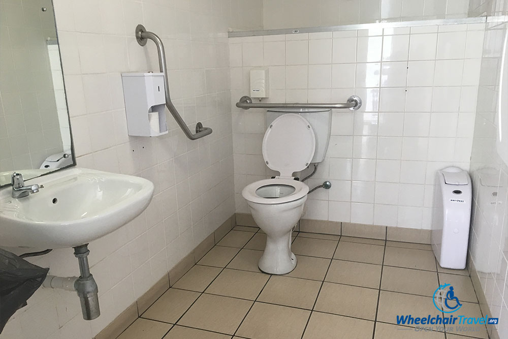 Wheelchair accessible toilet with grab bars